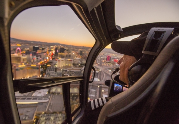 "Sundance Helicopter pilot David Lowe flies over the Las Vegas Strip on Tuesday, Dec. 29, 2015. The company is providing flights over the Strip during the ""America's Party"" on New Y ..."