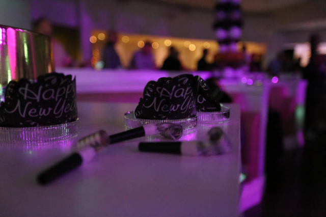 New Year's party favors sit on a table at the Evolve Vegas party in the Havana Room at the Tropicana Hotel-Casino on the Strip in Las Vegas on New Year's Eve Thursday, Dec. 31, 2015. B ...