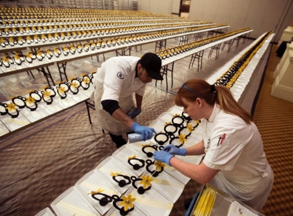 Amy Byro-Burhen and a co-worker on Wednesday prepare chocolate centerpieces for a New Year's Eve party at Caesars Palace.  (Jeff Scheid/Las Vegas Review-Journal)