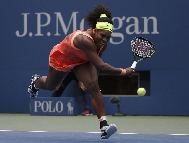 Serena Williams runs down a return from Roberta Vinci of Italy in the third set during their women's singles semifinal match at the U.S. Open Championships tennis tournament in New York, Sep ...