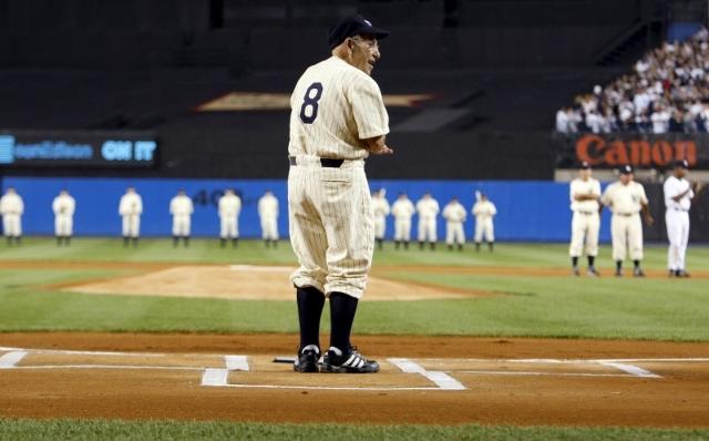 Former New York Yankee Yogi Berra stands at home plate before the final regular season MLB American Leugue baseball game at Yankee Stadium in New York in this September 21, 2008 file photo.  REUTE ...