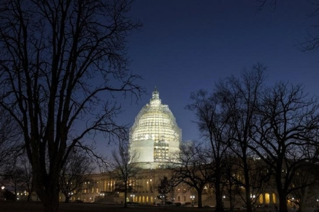 The U.S. Capitol is lit in Washington February 11, 2015. (Reuters/Joshua Roberts)