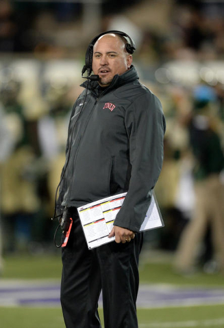 UNLV Rebels coach Tony Sanchez in the second quarter against the Colorado State Rams at Sonny Lubick Field at Hughes Stadium. Mandatory Credit: Ron Chenoy-USA TODAY Sports
