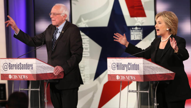Bernie Sanders and Hillary Clinton gesture as they speak during a Democratic presidential debate at Drake University. Mandatory Credit: Rodney White/The Des Moines Register via USA TODAY Sports