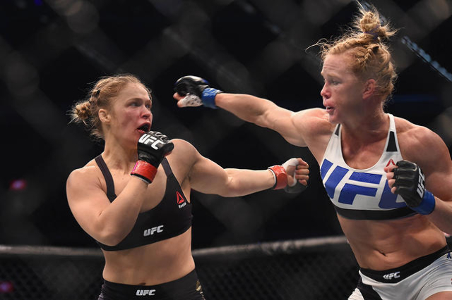Nov 15, 2015; Melbourne, Australia; Ronda Rousey (red gloves) competes against Holly Holm (blue gloves) during UFC 193 at Etihad Stadium. (Matt Roberts/USA Today Sports)