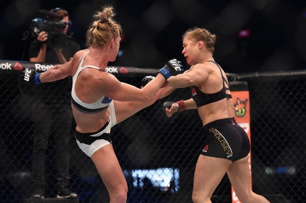 Nov 15, 2015; Melbourne, Australia; Ronda Rousey (red gloves) competes against Holly Holm (blue gloves) during UFC 193 at Etihad Stadium. Mandatory Credit: Matt Roberts-USA TODAY Sports