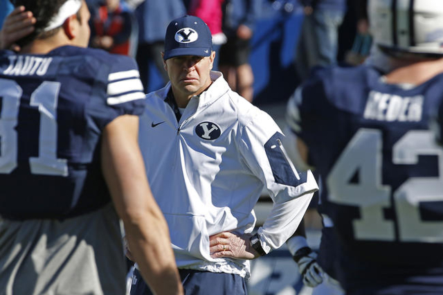 Nov 21, 2015; Provo, UT, USA; Brigham Young Cougars head coach Bronco Mendenhall keeps an eye on his team prior to their game against the Fresno State Bulldogs at Lavell Edwards Stadium. (Jeff Swi ...