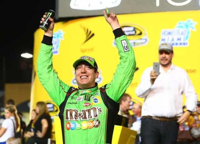 NASCAR Sprint Cup Series driver Kyle Busch celebrates in victory lane after winning the Ford EcoBoost 400 to win the Sprint Cup championship at Homestead-Miami Speedway. (Mark J. Rebilas/USA TODAY ...