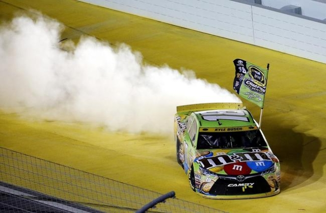Nov 22, 2015; Homestead, FL, USA; Sprint Cup Series driver Kyle Busch (18) celebrates after winning the NASCAR Sprint Cup Championship after the Ford EcoBoost 400 at Homestead-Miami Speedway. Mand ...