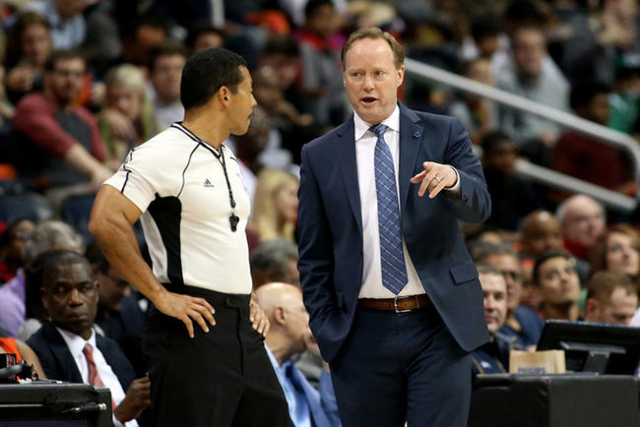Nov 24, 2015; Atlanta, GA, USA; Atlanta Hawks head coach Mike Budenholzer talks with referee Bill Kennedy (55) in the first quarter of their game against the Boston Celtics at Philips Arena. (Jaso ...