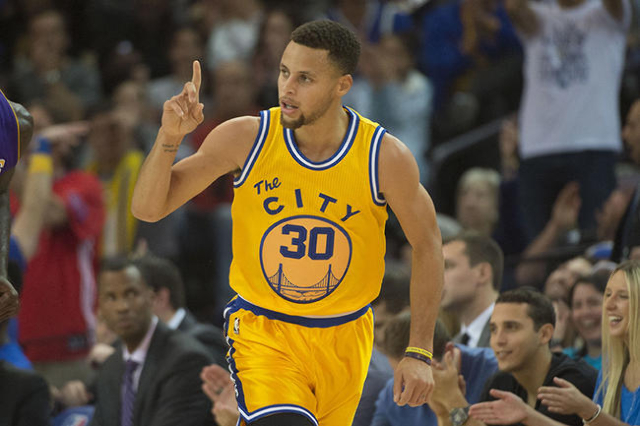 November 24, 2015; Oakland, CA, USA; Golden State Warriors guard Stephen Curry (30) celebrates against the Los Angeles Lakers during the first quarter at Oracle Arena. Mandatory Credit: Kyle Terad ...