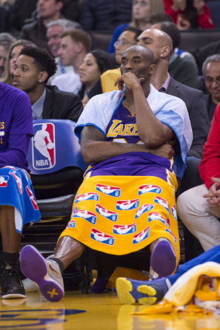 November 24, 2015; Oakland, CA, USA; Los Angeles Lakers forward Kobe Bryant (24) sits on the bench during the fourth quarter against the Golden State Warriors at Oracle Arena. The Warriors defeate ...