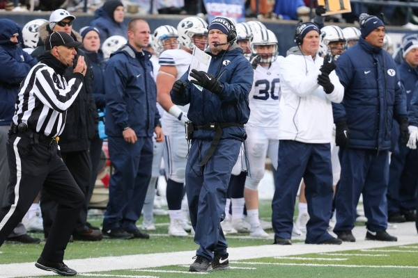 Nov 28, 2015; Logan, UT, USA; Brigham Young Cougars head coach Bronco Mendenhall calls time-out during the third quarter against the Utah State Aggies at Romney Stadium. Brigham Young Cougars won  ...
