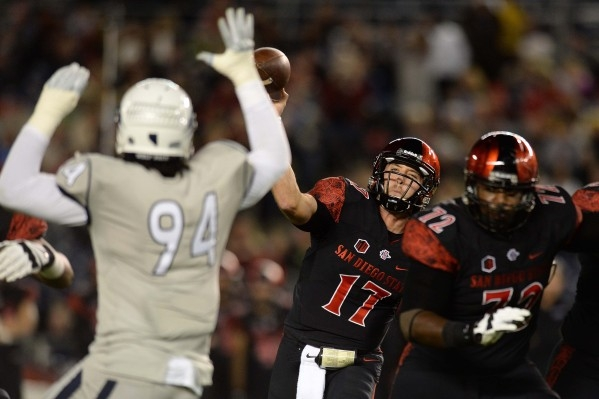 Nov 28, 2015; San Diego, CA, USA; San Diego State Aztecs quarterback Maxwell Smith (17) passes as Nevada Wolf Pack defensive end Lenny Jones (94) defends during the first quarter at Qualcomm Stadi ...