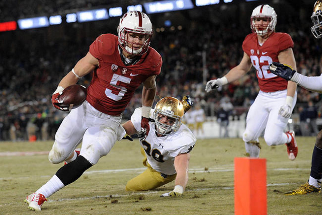 November 28, 2015; Stanford, CA, USA; Stanford Cardinal running back Christian McCaffrey (5) runs the ball against Notre Dame Fighting Irish linebacker Joe Schmidt (38) during the second half at S ...