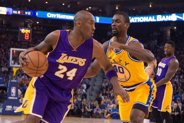 Los Angeles Lakers forward Kobe Bryant (24) dribbles against Golden State Warriors forward Harrison Barnes (40) during the first quarter at Oracle Arena.  (Kyle Terada-USA TODAY Sports)