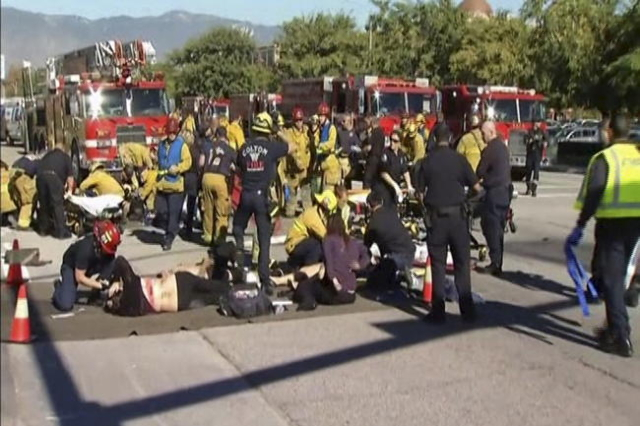 Rescue crews tend to the injured in the intersection outside the Inland Regional Center in San Bernardino, California in this still image taken from video December 2, 2015. (Reuters)