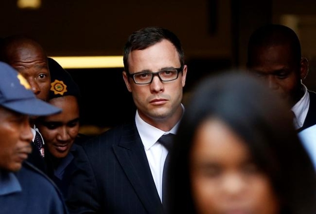 Paralympic track star Oscar Pistorius (C) leaves after listening to the closing arguments in his murder trial at the high court in Pretoria August 7, 2014. REUTERS/Siphiwe Sibeko/Files