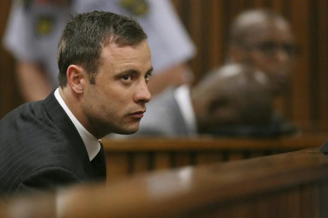 South African Olympic and Paralympic track star Oscar Pistorius listens to the verdict in his trial at the high court in Pretoria September 12, 2014. (Siphiwe Sibeko/Reuters)
