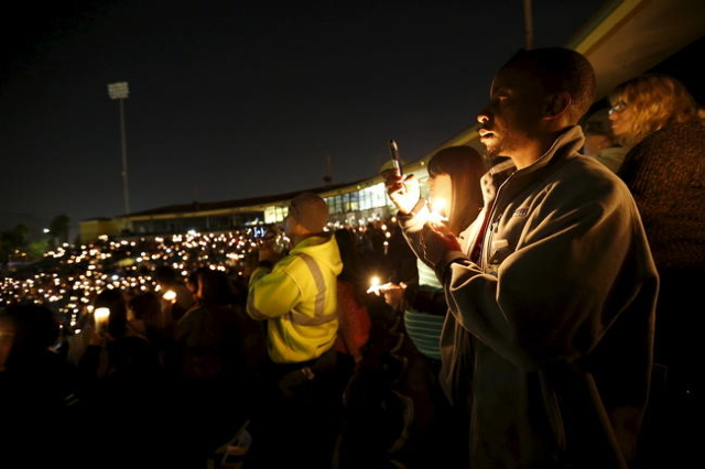 Attendees reflect on the tragedy of Wednesday's attack during a candlelight vigil in San Bernardino, California December 3, 2015.  REUTERS/Mario Anzuoni
