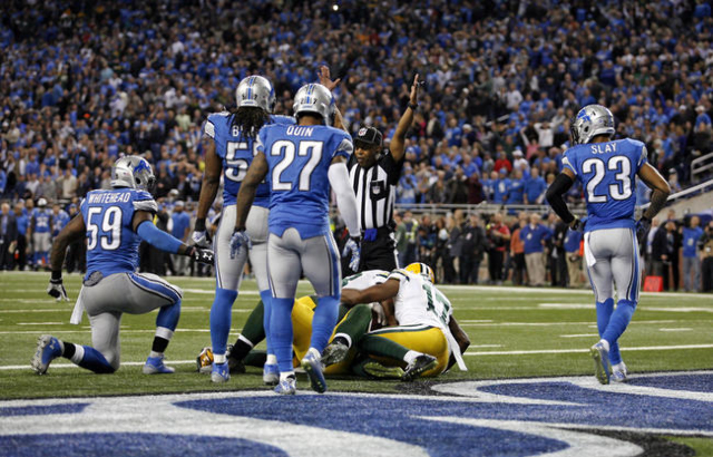 Dec 3, 2015; Detroit, MI, USA; Green Bay Packers tight end Richard Rodgers (82) catches a touchdown pass with no time left during the fourth quarter against the Detroit Lions at Ford Field. Packer ...