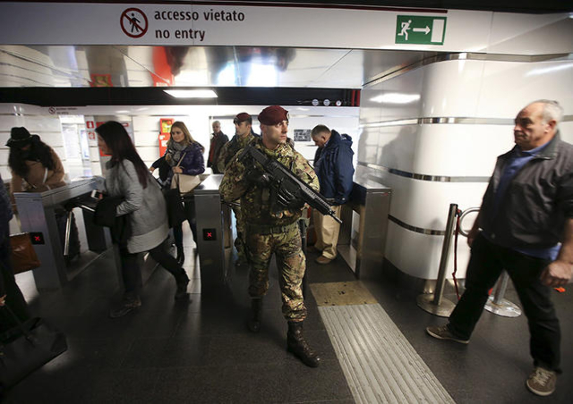 A soldier patrols in a subway station in Rome, Italy, November 23, 2015. Rome is bracing for the arrival of millions of pilgrims for the  Roman Catholic Holy Year which officials had hoped could r ...