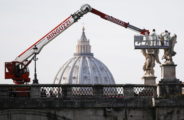 Workers clean statues in Rome, Italy, November 30, 2015. Rome is bracing for the arrival of millions of pilgrims for the  Roman Catholic Holy Year which officials had hoped could revitalise the sc ...