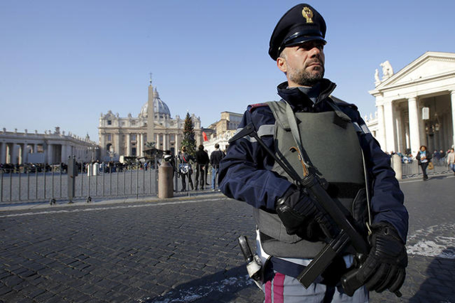 A policeman patrols in front of the Vatican in Rome, Italy, December 4, 2015. Rome is bracing for the arrival of millions of pilgrims for the  Roman Catholic Holy Year which officials had hoped co ...