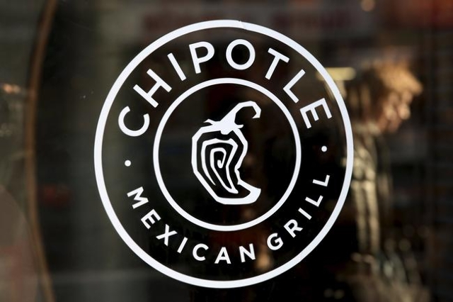 A logo of Chipotle Mexican Grill is seen on a store entrance in Manhattan, New York, Nov. 23, 2015. (Andrew Kelly/Reuters)