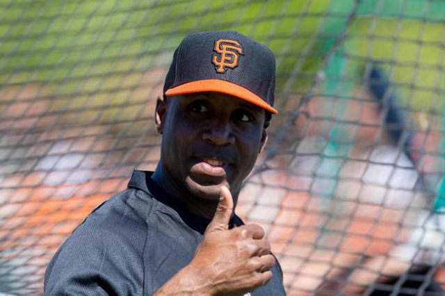 San Francisco Giants former outfielder Barry Bonds reacts during batting practice prior to the game against the Chicago Cubs at Scottsdale Stadium. (Mark J. Rebilas/USA Today Sports)
