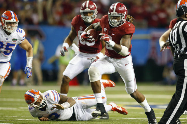 Dec 5, 2015; Atlanta, GA, USA; Alabama Crimson Tide running back Derrick Henry (2) carries the ball against the Florida Gators during the fourth quarter in the 2015 SEC Championship Game at the Ge ...