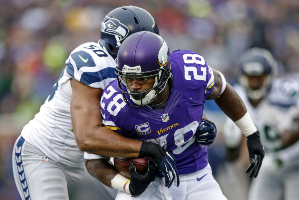 Dec 6, 2015; Minneapolis, MN, USA; Seattle Seahawks linebacker K.J. Wright (50) stops Minnesota Vikings running back Adrian Peterson (28) on a 3 yard pass play in the second quarter at TCF Bank St ...