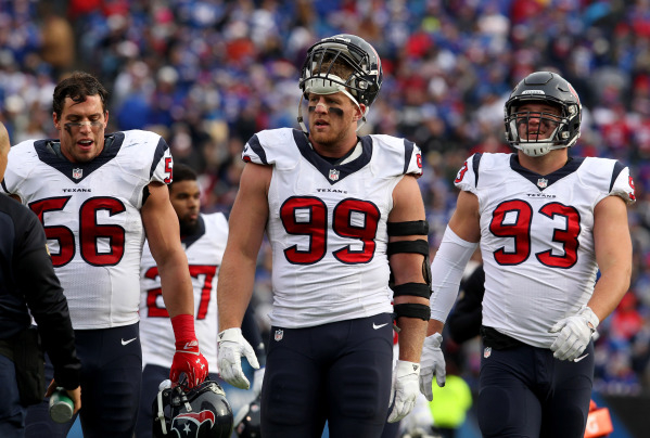 Dec 6, 2015; Orchard Park, NY, USA; Houston Texans inside linebacker Brian Cushing (56) and defensive end J.J. Watt (99) and defensive end Jared Crick (93) after the first quarter against the Buff ...