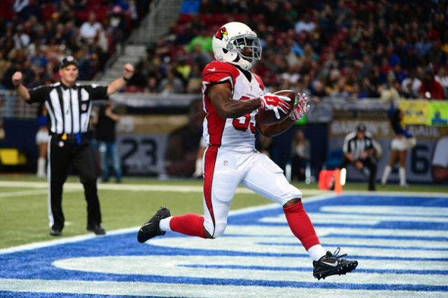 Dec 6, 2015; St. Louis, MO, USA; Arizona Cardinals running back Kerwynn Williams (33) runs in for a 35 yard touchdown against the St. Louis Rams during the second half at the Edward Jones Dome. Th ...