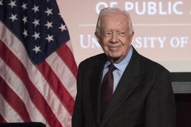 Former U.S. President Jimmy Carter arrives to speak during an event honoring former U.S. Vice President Walter Mondale hosted by the Humphrey School of Public Affairs at the University of Minnesot ...