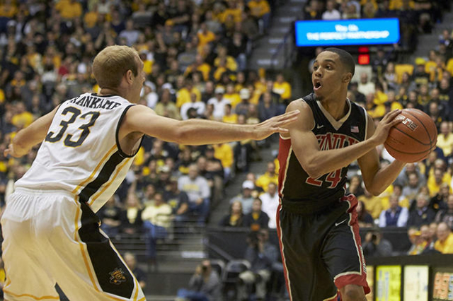 Dec 9, 2015; Wichita, KS, USA; UNLV Rebels guard Jalen Poyser (24) looks to pass the ball with Wichita State Shockers guard Conner Frankamp (33) defending at Charles Koch Arena. Mandatory Credit:  ...
