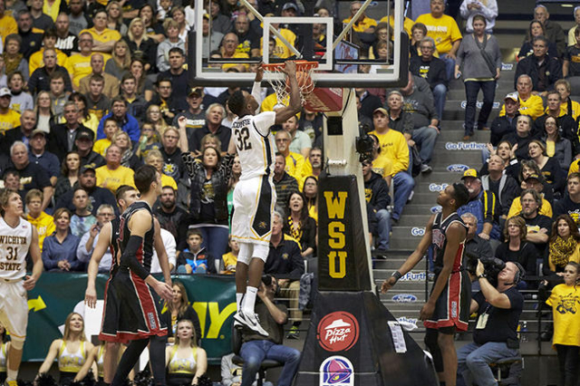 Dec 9, 2015; Wichita, KS, USA; Wichita State Shockers forward Markis McDuffie (32) dunks the ball in front of UNLV Rebels forward Ben Carter (13) and UNLV Rebels forward Derrick Jones Jr. (1) at C ...