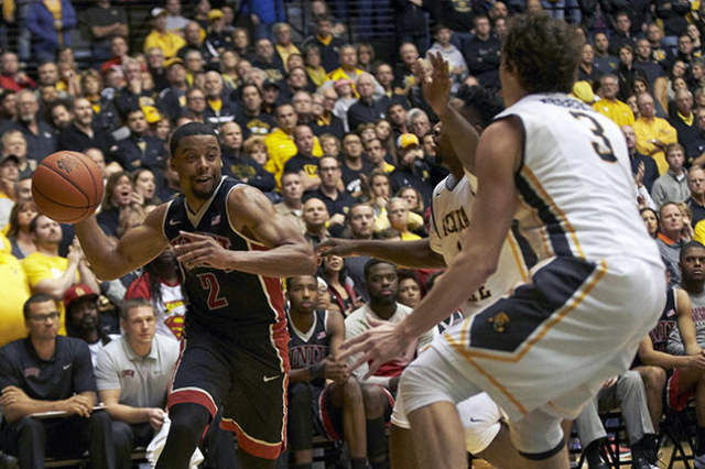 Dec 9, 2015; Wichita, KS, USA; UNLV Rebels guard Jerome Seagears (2) tries to get a pass by Wichita State Shockers guard Evan Wessel (3) at Charles Koch Arena. Mandatory Credit: Gary Rohman-USA TO ...