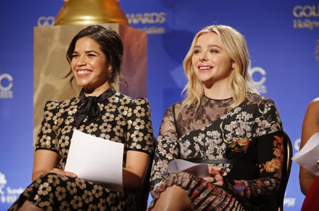 Actresses America Ferrera and Chloe Grace Moretz (R) smile before announcing the nominations for the 73rd annual Golden Globe Awards in Beverly Hills, California December 10, 2015. The awards will ...