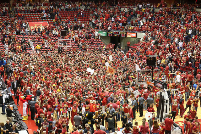 Dec 10, 2015; Ames, IA, USA; Iowa State Cyclones students rush the court after beating the Iowa Hawkeyes at James H. Hilton Coliseum. The Cyclones beat the Hawkeyes 83-82. (Reese Strickland/USA To ...