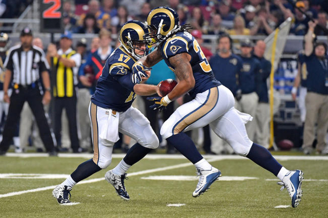 Dec 13, 2015; St. Louis, MO, USA; St. Louis Rams quarterback Case Keenum (17) hands the ball of to St. Louis Rams running back Todd Gurley (30) against the Detroit Lions during the first half at t ...