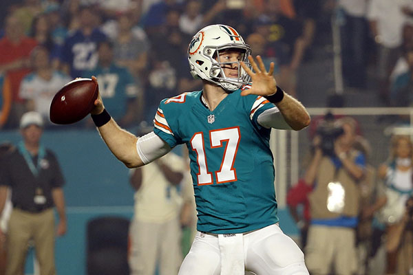 Dec 14, 2015; Miami Gardens, FL, USA; Miami Dolphins quarterback Ryan Tannehill (17) throws a pass against the New York Giants during the first half at Sun Life Stadium. Mandatory Credit: Steve Mi ...