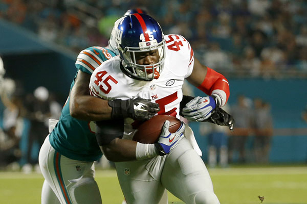 Dec 14, 2015; Miami Gardens, FL, USA; Miami Dolphins linebacker Jelani Jenkins (53) tackles New York Giants tight end Will Tye (45) during the first half at Sun Life Stadium. Mandatory Credit: Ste ...