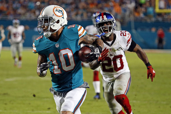 Dec 14, 2015; Miami Gardens, FL, USA; Miami Dolphins wide receiver Kenny Stills (10) hauls in a touchdown catch in front of New York Giants cornerback Prince Amukamara (20) during the second half  ...