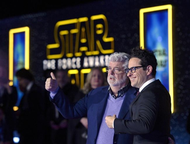 "Star Wars creator George Lucas, left, and director JJ Abrahms pose at the premiere of ""Star Wars: The Force Awakens"" in Hollywood, Calif., Dec. 14, 2015. (Kevork Djansezian/Reuters)"