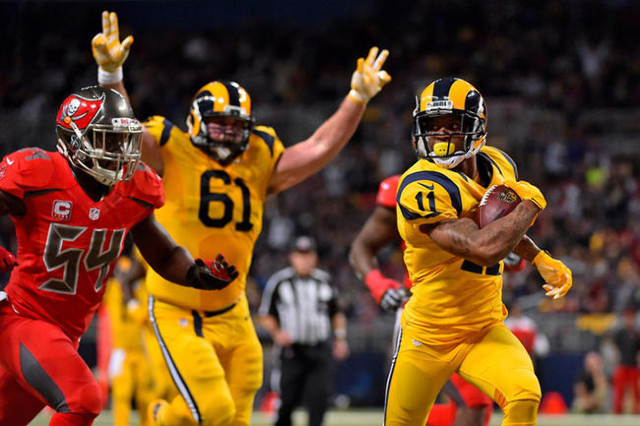 Dec 17, 2015; St. Louis, MO, USA; St. Louis Rams wide receiver Tavon Austin (11) runs the ball in for a touchdown against the Tampa Bay Buccaneers during the second half at the Edward Jones Dome.  ...