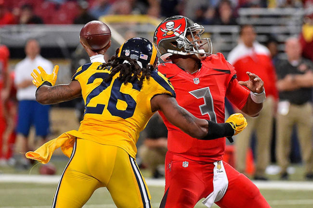 Dec 17, 2015; St. Louis, MO, USA; St. Louis Rams outside linebacker Mark Barron (26) pressures Tampa Bay Buccaneers quarterback Jameis Winston (3) during the second half at the Edward Jones Dome.  ...