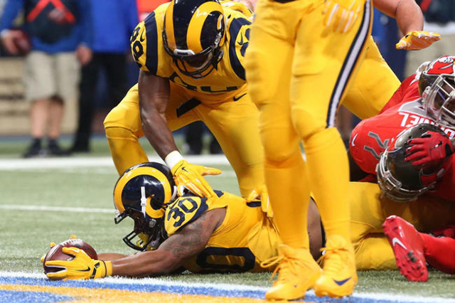 Dec 17, 2015; St. Louis, MO, USA; St. Louis Rams running back Todd Gurley (30) scores a touchdown in the fist half against the Tampa Bay Buccaneers at the Edward Jones Dome. The Rams won 31-23. Ma ...