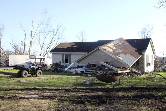 A damaged home is seen after being struck by a powerful tornado in Clarksdale, Mississippi, December 24, 2015. REUTERS/Justin A. Shaw