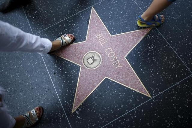People walk over Bill Cosby's star of the Hollywood Walk of Fame in Los Angeles, July 9, 2015. (Lucy Nicholson/Reuters)